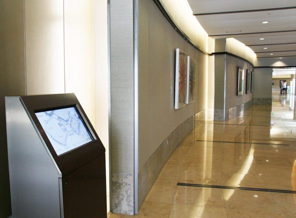 Secondary Entrance to Hospital with Digital Wayfinding Kiosk in Foreground